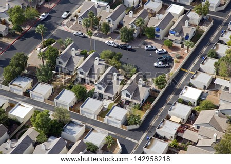 Homes with detached garages in a Southwest subdivision - stock photo