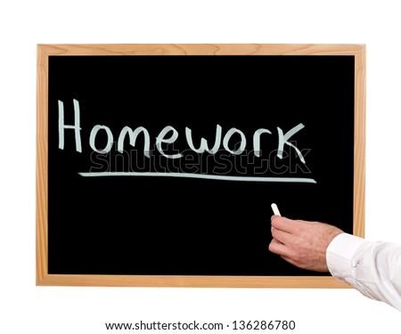 Homework is written in chalk on a chalkboard. - stock photo