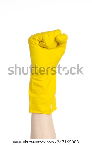 Homework, washing and cleaning of the theme: man's hand holding a yellow and wears rubber gloves for cleaning isolated on white background in studio