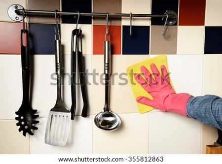 Homework -  woman Cleaning  the kitchenn