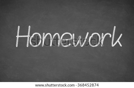 Homework written on chalkboard. White chalk and blackboard