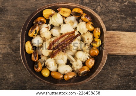 hominy and toasted corn nuts mote with tostado on wooden spoon ecuadorian traditional food - stock photo