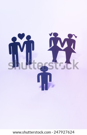 Homosexual and gay couple with child, figurines - stock photo