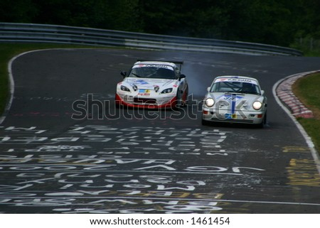 Honda passing an older porsche in a curve