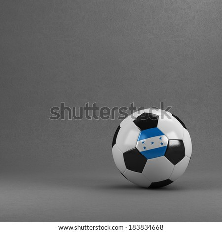 Honduran soccer ball in front of plaster wall - stock photo