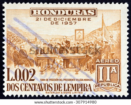 HONDURAS - CIRCA 1959: A stamp printed in Honduras issued for the  2nd Anniversary of New Constitution shows Inauguration of President Ramon Villeda Morales, circa 1959.  - stock photo
