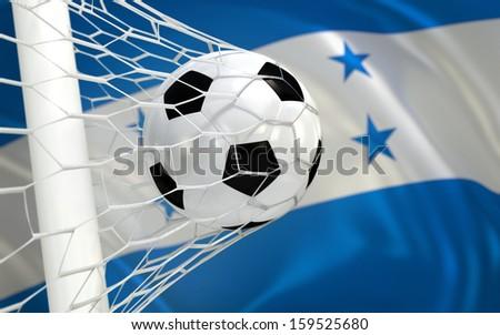Honduras waving flag and soccer ball in goal net - stock photo