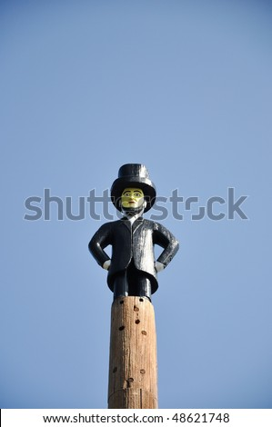 Honest Abe perched on top of totem - stock photo