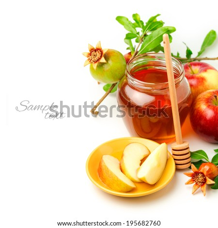 Honey and apples with pomegranate over white background - stock photo
