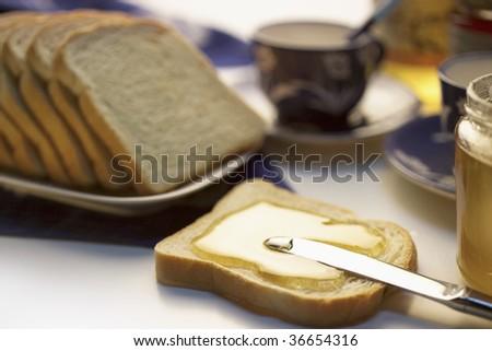 Honey and bread breackfast still life - stock photo