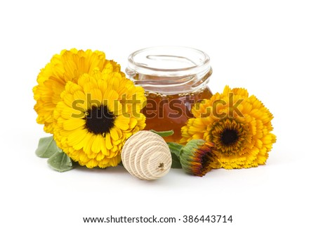 honey and calendula flowers on white background