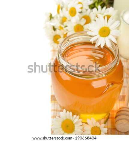 Honey and chamomile on a  white background