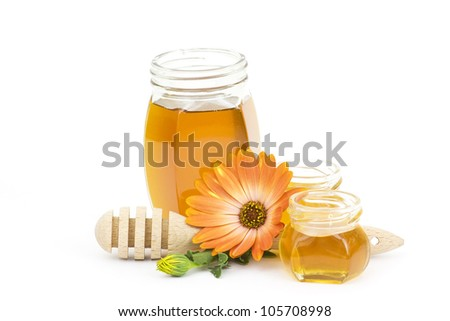 honey and flower on white