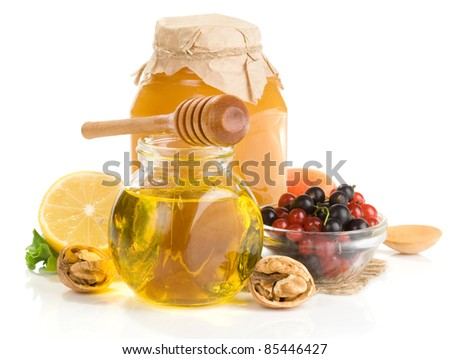 honey and fruit isolated on white background - stock photo