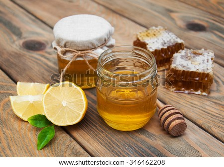 honey and lemon on a old wooden background - stock photo