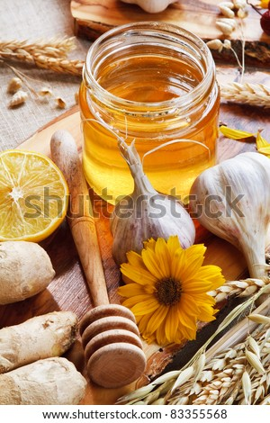 Honey and others natural medicine for the winter flue (garlic, lemon ginger). Rustic still life. - stock photo