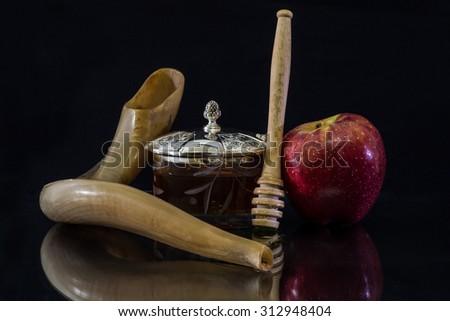 Honey and shofar  and apple for Rosh Hashanah (Jewish New Year) - stock photo