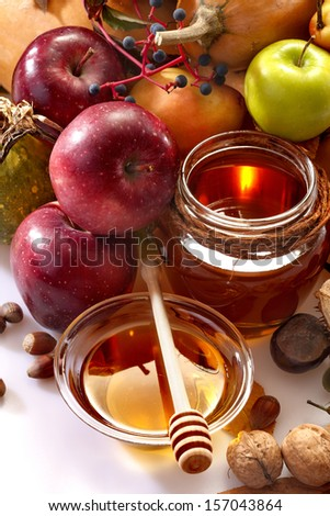 honey, apples and autumn fruits - stock photo