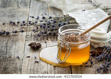 Honey. Breakfast. Lavender, wheat decoration. Wooden background. - stock photo