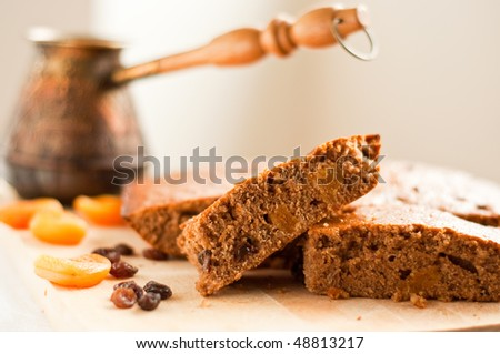 Honey-cake and a coffee pot - stock photo