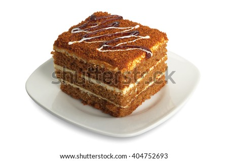 Honey cake in plate on white background