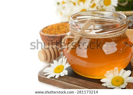 Honey, chamomile and pollen on a white background - stock photo