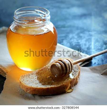 honey dipper and bread - stock photo