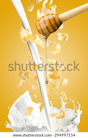 Honey Drip Into Bowl of Cereal and Milk Splash - stock photo