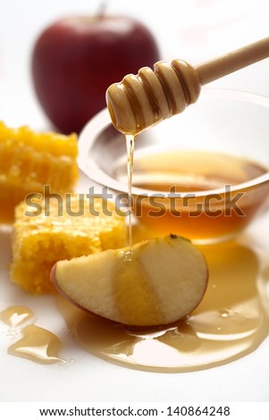 Honey dripping on a apple - stock photo