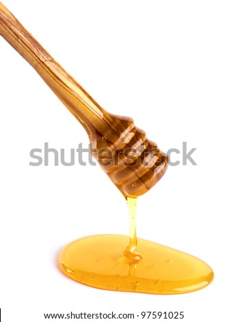 honey flowing down from a wooden honey dipper isolated on white background - stock photo