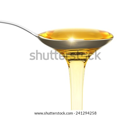 Honey flowing from a teaspoon isolated on white - stock photo