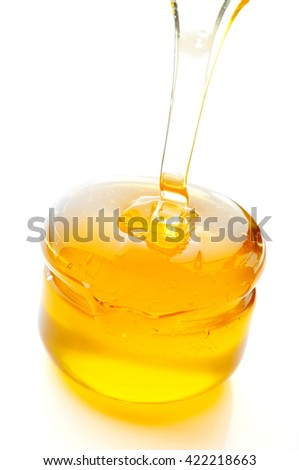 Honey flowing isolated on white background.