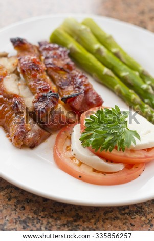 Honey glazed chicken with asparagus and caprese salad