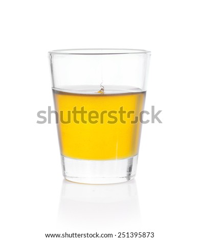 Honey in a glass on white background