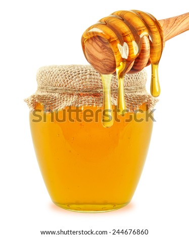 honey in jar and dipper isolated on white background - stock photo