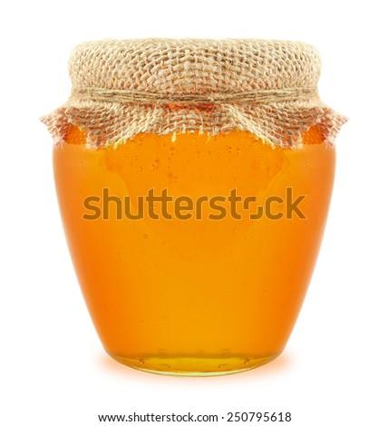 honey in jar isolated on white background - stock photo