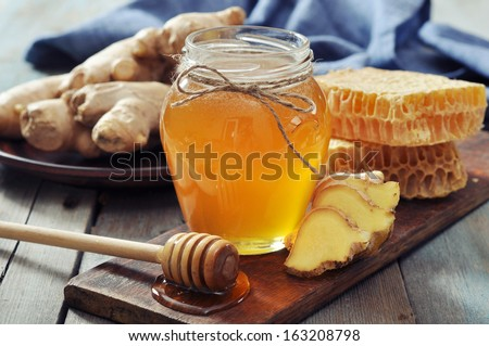 Honey in jar with fresh ginger on vintage wooden background  - stock photo