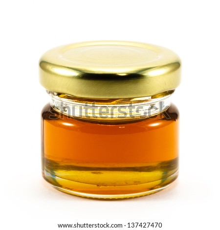 Honey in the bottle glass isolated on white background - stock photo