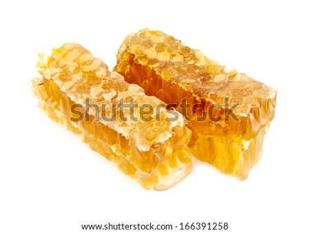 honey in the comb on a white background - stock photo