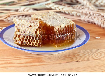 honey in the comb on a wooden table