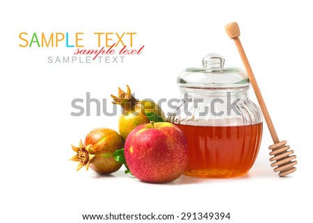 Honey jar and fresh apples with pomegranate on white background - stock photo