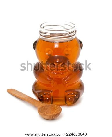 honey jar and spoon - stock photo