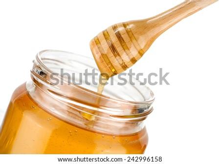 Honey jar isolated on white background - stock photo