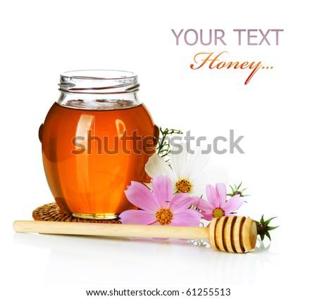 Honey jar over white - stock photo