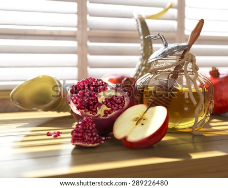Honey jar with apples and pomegranate for Jewish New Year Holiday rosh hashanah - stock photo