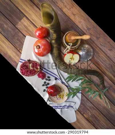 Honey jar with apples and pomegranate for Rosh Hashana religious holiday - stock photo