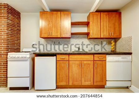 Honey kitchen cabinets with white appliances and tile back splash trim