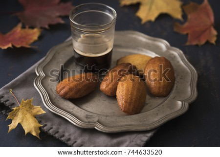 Honey madeleines with a cup of coffee