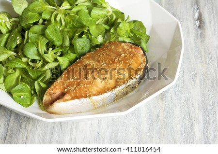Honey-mustard salmon served with corn salad - stock photo