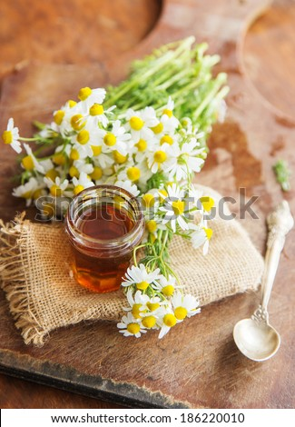 Honey on a wooden table - stock photo